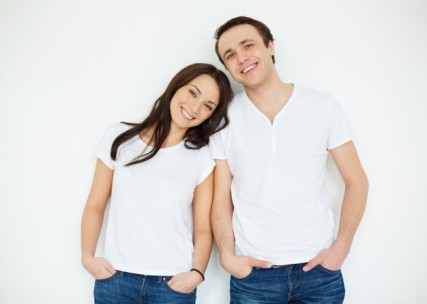 couple-with-white-shirts-and-jeans_1098-2090